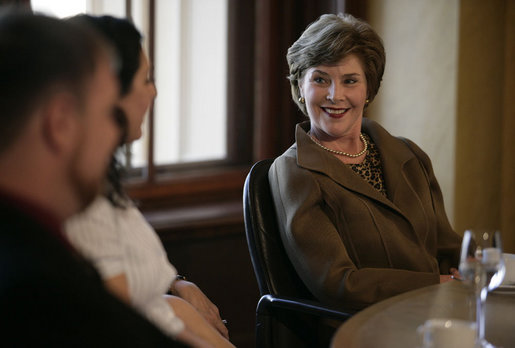Mrs. Laura Bush smiles as she listens to a participant Wednesday, June 6, 2007, during a roundtable discussion with Fulbright Scholars at the Schwerin Castle in Schwerin, Germany. White House photo by Shealah Craighead