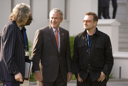President George W. Bush shares a moment with Irish rocker Bono, Sir Bob Geldof, left, and Senegalese singer Youssou N'Dour Wednesday, June 6, 2007, the Kempinski Grand Hotel in Heiligendamm, Germany, site of the 2007 G8 Summit. White House photo by Shealah Craighead