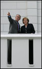 President George W. Bush and German Chancellor Angela Merkel stand on a balcony at the Kempinski Grand Hotel Wednesday, June 6, 2007, in Heiligendamm, Germany, site of the 2007 G8 Summit. White House photo by Eric Draper