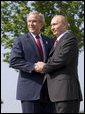 President George W. Bush and President Vladimir Putin of Russia, exchange handshakes Thursday, June 7, 2007, after their meeting at the G8 Summit in Heiligendamm, Germany. White House photo by Eric Draper