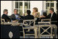 President George W. Bush sits with fellow G8 leaders Thursday afternoon, June 7, 2007, during a reception prior to dinner on the terrace of the Kempinski Grand Hotel in Heiligendamm, Germany. Clockwise from the President are: Chancellor Angela Merkel of Germany; Prime Minister Tony Blair of the United Kingdom; Prime Minister Romano Prodi of Italy; Jose Manuel Barroso, President of the European Commission, and Prime Minister Stephen Harper of Canada. White House photo by Eric Draper