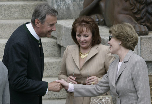 With Mrs. Lyudmila Putina looking on, Mrs. Laura Bush is greeted at Schlitz Castle by Mathias Stinnes, owner of Burg Schlitz and acting partner of the Hugo Stinnes Company, Thursday, June 7, 2007, in Hohen Demzin, Germany. The castle hotel was the sight of the official G8 spouse program. White House photo by Shealah Craighead