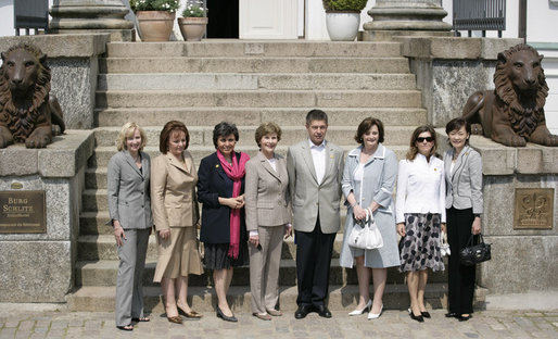 Partners of the G8 leaders pose outside Burg Schlitz Thursday, June 7, 2007, in Hohen Demzin, Germany. From left are: Mrs. Laureen Harper, Mrs. Lyudmila Putina, Mrs. Flavia Franzoni, Mrs. Laura Bush, Dr. Joachim Sauer, Mrs. Cherie Booth Blair, Mrs. Maria Margarida Pinto Ribeiro Sousan Uva Barroso and Mrs. Akie Abe. White House photo by Shealah Craighead