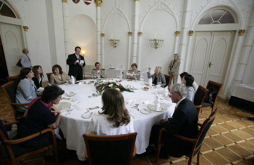 Mrs. Laura Bush joins other spouses of G8 leaders Thursday, June 7, 2007, for lunch in the Knights' Hall at Burg Schlitz in Hohen Demzin, Germany. White House photo by Shealah Craighead