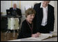 Mrs. Laura Bush signs the Golden Book after arriving at Wismar City Hall in Wismar, Germany Thursday, June 7, 2007, to participate in a program for G8 spouses. Looking on is Dr. Rosemarie Wilcken, Mayor of Wismar. White House photo by Shealah Craighead