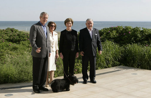 President George W. Bush and Mrs. Laura Bush join Polish President Lech Kaczynski and Maria Kaczynski, with their dog Titus, for a stroll Friday, June 8, 2007, at the Polish presidential seaside retreat in Jurata, Poland. White House photo by Eric Draper