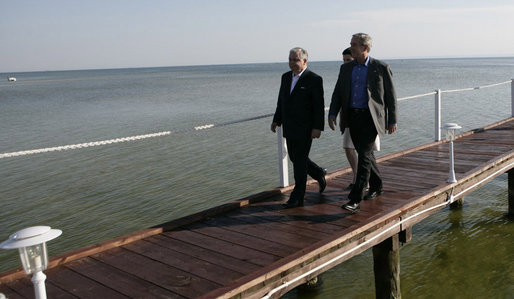 President George W. Bush and Polish President Lech Kaczynski walk along a dock Friday, June 8, 2007, at the Polish presidential seaside retreat in Jurata, Poland. White House photo by Eric Draper