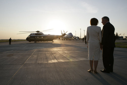 Polish President Lech Kaczynski and his wife, Maria, wait to greet President George W. Bush and Mrs. Laura Bush arriving aboard Marine One, on their trip back to Gdansk after visiting the presidential retreat in Jurata, Poland, Friday, June 8, 2007. White House photo by Eric Draper