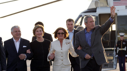 President George W. Bush and Mrs. Laura Bush are welcomed Friday, June 8, 2007, on their arrival to Gdansk, Poland, by Polish President Lech Kaczynski and his wife, Maria. White House photo by Eric Draper