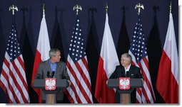 "President George W. Bush draws a smile from Poland's President Lech Kaczynski during their joint statement Friday, June 8, 2007, in Gdansk. Said President Bush, ""One thing I do want to do is praise this good country for being so strong for freedom. I love to be in a land where people value liberty, and are willing to help others realize the blessings of liberty.""  White House photo by Chris Greenberg"