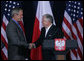 President George W. Bush and President Lech Kaczynski of Poland, shake hands at the conclusion of their joint statement Friday, June 8, 2007, at Gdansk Lech Walesa International Airport in Gdansk. White House photo by Chris Greenberg