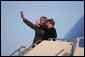 President George W. Bush and Mrs. Laura Bush wave as they board Air Force One for departure from Poland Friday, June 8, 2007, at Gdansk Lech Walesa International Airport in Gdansk. White House photo by Chris Greenberg