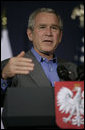 "President George W. Bush delivers his remarks during a joint statement Friday, June 8, 2007, with President Lech Kaczynski of Poland in Gdansk. President Bush told the leader, ""I thank you, Mr. President, for your leadership in the cause of freedom. You're very much involved in the cause of freedom in two very difficult theaters: Afghanistan and Iraq. I thank you and I thank the people of Poland for the sacrifices they made so that others may live in a free society."" White House photo by Shealah Craighead"