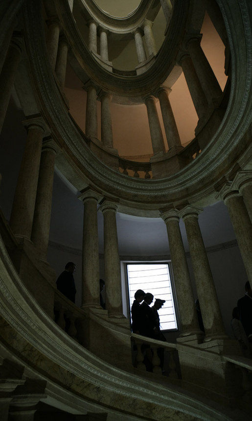 President George W. Bush and Mrs. Laura Bush are silhouetted as they descend a circular stairwell with Gen. Rolando Mosca Moschini, military advisor to President Giorgio Napolitano of Italy, during a visit to Quirinale Palace Saturday, June 9, 2007, in Rome. White House photo by Eric Draper