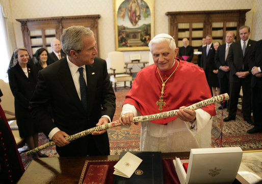 Pope Benedict XVI smiles as he holds a walking stick presented to him by President George W. Bush and Mrs. Laura Bush Saturday, June 9, 2007, during their visit to the Holy See. The walking stick, created by a former homeless Texas man, is adorned with the Ten Commandments in multiple colors. White House photo by Eric Draper