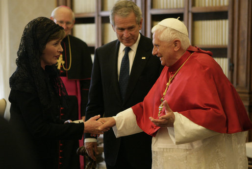 As President George W. Bush looks on, Mrs. Laura Bush shakes the hand of Pope Benedict XVI Saturday, June 9, 2007, during their visit to The Vatican in Rome. White House photo by Eric Draper