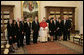 Pope Benedict XVI stands with President George W. Bush and Mrs. Laura Bush and members of the official U.S. delegation Saturday, June 9, 2007, during their visit to The Vatican. White House photo by Eric Draper