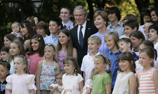 President George W. Bush and Mrs. Laura Bush pose for a photo Saturday, June 9, 2007, with children of employees and staff of the American Embassy in Rome. White House photo by Eric Draper