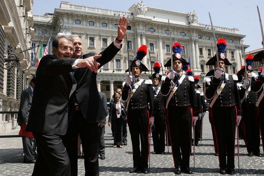 Italy's Prime Minister Romano Prodi points to someone in the courtyard audience as he welcomes President George W. Bush to Chigi Palace Saturday, June 9, 2007. The President and Mrs. Bush are scheduled to depart Rome Sunday for Albania and Bulgaria. White House photo by Chris Greenberg
