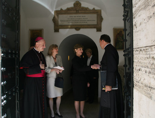 Mrs. Laura Bush shakes the hand of a Vatican official after visiting the tomb of Pope John Paul II Saturday, June 9, 2007, in Rome. White House photo by Shealah Craighead