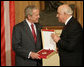 President George W. Bush accepts the Order of the National Flag Award from President Alfred Moisiu of Albania Sunday, June 10, 2007, during arrival ceremonies in Tirana welcoming the President and Mrs. Bush to the country. White House photo by Eric Draper