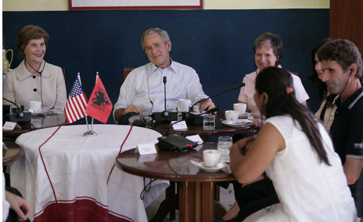 "President George W. Bush and Mrs. Laura Bush participate in a roundtable discussion at Cafe Cela in Fusche Kruje, Albania, Sunday, June 10, 2007, on the USAID Micro-Lending Program. Said the President, ""Laura and I thank the Mayor, we thank the owner of the restaurant, and we thank these entrepreneurs for joining us to talk about your story, about your dreams, and about the opportunities a micro-loan program, provided by the taxpayers of the United States, is giving you to create jobs."" White House photo by Eric Draper"