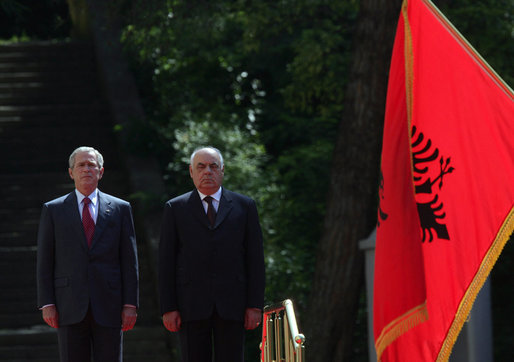 President George W. Bush stands next to President Alfred Moisiu of Albania, during arrival ceremonies Sunday, June 10, 2007, in Tirana, Albania. White House photo by Chris Greenberg