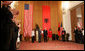 President George W. Bush receives the Order of the National Flag Award from President Alfred Moisiu during an arrival ceremony Sunday, June 10, 2007, in Tirana, Albania, as Mrs. Laura Bush and Ms. Mirela Moisiu look on. The visit by the President and Mrs. Bush marked the first to Albania by a sitting U.S. president. White House photo by Chris Greenberg