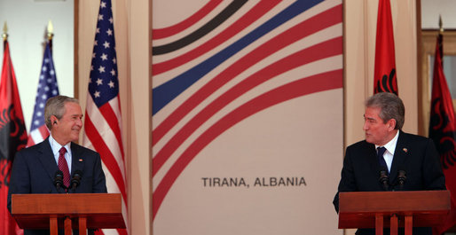 President George W. Bush smiles during a remark Sunday, June 10, 2007, by Albania's Prime Minister Sali Berisha during a joint press availability in Tirana, Albania. White House photo by Chris Greenberg