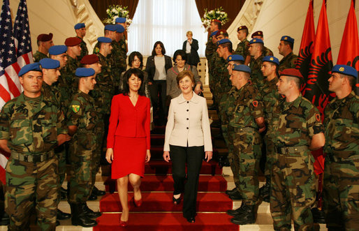Mrs. Laura Bush and Ms. Mirela Moisiu, daughter of President Alfred Moisiu of Albania, descend a staircase past Albanian troops at the Palace of Brigades in Tirana Sunday, June 10, 2007, during a daylong visit by President and Mrs. Bush. White House photo by Shealah Craighead