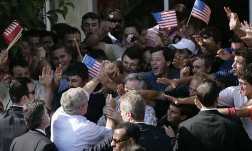 President George W. Bush reaches into a U.S. flag-waving crowd in Fushe Kruje, Albania Sunday, June 10, 2007, as hundreds of townspeople turned out to celebrate the first visit by a U.S. president to their country. White House photo by Shealah Craighead