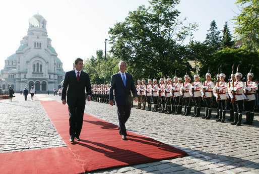 President George W. Bush and Bulgarian President Georgi Parvanov walk along a red carpet in Nevsky Square in Sofia, Bulgaria, Monday, June 11, 2007, during the official welcome for President Bush and Mrs. Laura Bush. White House photo by Eric Draper