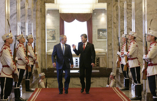 President George W. Bush and Bulgarian President Georgi Parvanov arrive for their meeting at the Coat of Arms Hall in Sofia, Bulgaria, Monday, June 11, 2007. White House photo by Eric Draper
