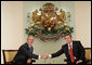 President George W. Bush and Bulgarian President Georgi Parvanov shake hands at their meeting in the Coat of Arms Hall in Sofia, Bulgaria, Monday, June 11, 2007. White House photo by Eric Draper