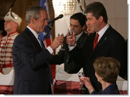 President George W. Bush and President Georgi Parvanov share a toast Monday, June 11, 2007, during a social lunch at The National Museum of History in Sofia, Bulgaria. White House photo by Chris Greenberg