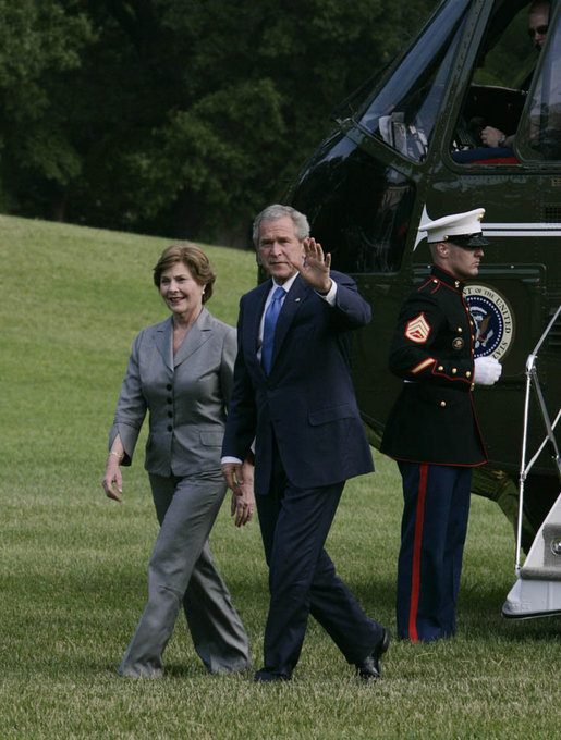 President George W. Bush and Mrs. Laura Bush return to the White House Monday afternoon, June 11, 2007, following their six-nation visit, including attending the G8 Summit. White House photo by Joyce Boghosian