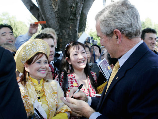 President George W. Bush signs autographs following his speech Tuesday, June 12, 2007, at the dedication ceremony for the Victims of Communism Memorial in Washington, D.C. White House photo by Joyce N. Boghosian