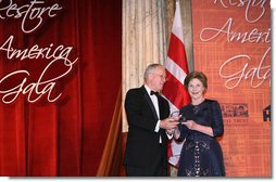 Mrs. Laura Bush is presented with an award by Dick Moe, president of the National Trust for Historic Preservation, Tuesday evening, June 12, 2007 in Washington, D.C., in recognition of Mrs. Bush's sustained commitment and contributions to the preservation of America's heritage.  White House photo by Shealah Craighead