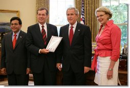 President George W. Bush receives the Report to the President on Issues Raised by the Virginia Tech Tragedy in the Oval Office Wednesday, June 13, 2007, presented to President Bush by Attorney General Alberto Gonzales; U.S. Secretary of Health and Human Services Michael O. Leavitt and U.S. Secretary of Education Margaret Spellings. The report was compiled by the departments of Justice, Health and Human Services and Education in response to the tragic shooting rampage at Virginia Tech April 16, 2007 in Blacksburg, Va.  White House photo by Eric Draper
