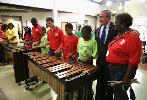 "President George W. Bush listens as kids at the Boys and Girls Club of South Central Kansas-21st Street Club play ""Hail to the Chief"" during his visit Friday, June 15, 2007, to Wichita. White House photo by Eric Draper"