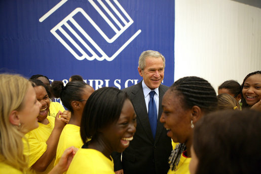 "President George W. Bush is surrounded by kids at the Boys and Girls Club of South Central Kansas - 21st Street during his stop Friday, June 15, 2007, in Wichita. Said the President, ""I think it's very important for the people of Wichita to support a program such as this -- after all, we can change our country one heart and one soul at a time. And I'm really pleased to be here."" White House photo by Eric Draper"
