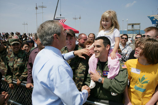 "President George W. Bush greets Boeing employees and military base personnel and families after arriving Friday, June 15, 2007, at McConnell Air Force Base in Wichita. More than 1500 people were on hand to greet the President, who told them, "" I'm honored to be here with Senator Pat Roberts and Vicki Tiahrt. They're strong supporters of the programs here, strong supporters of Boeing. I appreciate you coming out to say hello."" White House photo by Eric Draper"
