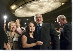 "President George W. Bush greets audience members after addressing the National Hispanic Prayer Breakfast Friday, June 15, 2007, in Washington, D.C. ""Our nation is more hopeful because of the Hispanic Americans who serve in the armies of compassion, who are surrounding neighbors in need who hurt with love; people who are helping to change America one heart and one soul and one conscience at a time,"" said the President in his remarks. White House photo by Joyce N. Boghosian"