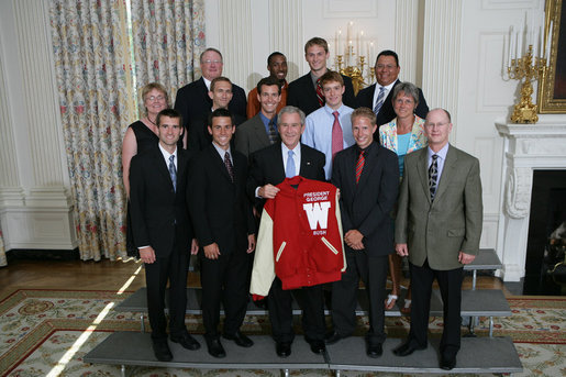 President George W. Bush stands with members of the University of Wisconsin-Madison Men's Indoor Track and Field 2007 Championship Team Monday, June 18, 2007 at the White House, during a photo opportunity with the 2006 and 2007 NCAA Sports Champions. White House photo by Eric Draper