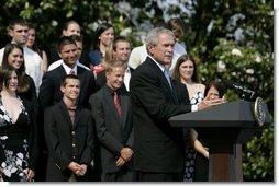 President George W. Bush delivers remarks to the 2006 and 2007 NCAA Championship teams Monday, June 18, 2007 on the South Lawn.  White House photo by Eric Draper