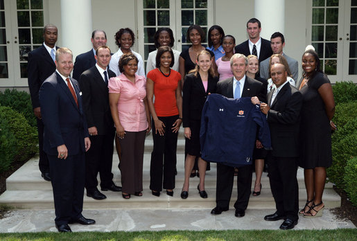 President George W. Bush stands with members of the Auburn University Women's Outdoor Track and Field 2006 Championship Team Monday, June 18, 2007 at the White House, during a photo opportunity with the 2006 and 2007 NCAA Sports Champions. White House photo by Chris Greenberg