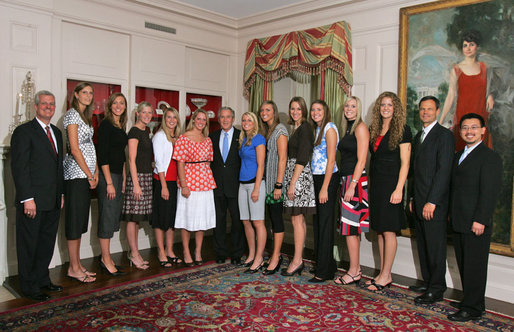 President George W. Bush stands with members of the University of Nebraska Women's Volleyball 2006 Championship Team Monday, June 18, 2007 at the White House, during a photo opportunity with the 2006 and 2007 NCAA Sports Champions. White House photo by Joyce N. Boghosian