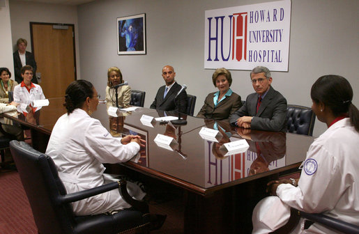 Mrs. Laura Bush participates in a roundtable at the Howard University Center for Infectious Disease Management and Research Tuesday, June 19, 2007, in Washington, D.C. Pictured with Mrs. Bush is, from left, Dr. Celia Maxwell, Director of the Women's Health Initiative, D.C. Mayor Adrian Fenty and Dr. Tony Fauci, Director of the National Institute of Allergy and Infectious Diseases, National Institutes of Health. Dr. Maxwell invited experts to discuss HIV/AIDS and voluntary HIV testing. Howard University hospital, which is the first facility to implement throughout its entire institution voluntary HIV testing as part of routine medical care. White House photo by Shealah Craighead