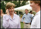 Mrs. Laura Bush surprises a caller on guest's cell phone Tuesday evening, June 19, 2007, at the annual White House Congressional Picnic on the South Lawn. White House photo by Shealah Craighead