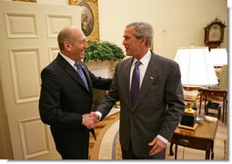 President George W. Bush welcomes Prime Minister Ehud Olmert of Israel to the Oval Office Tuesday, June 19, 2007. White House photo by Eric Draper